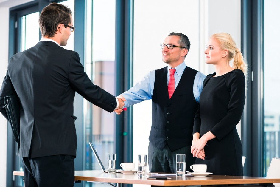 Business - young man in job interview for hiring, welcomes, Boss