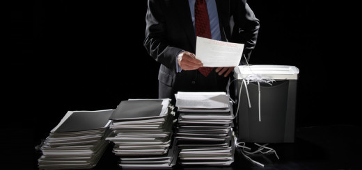 business-man-shredding-documents1