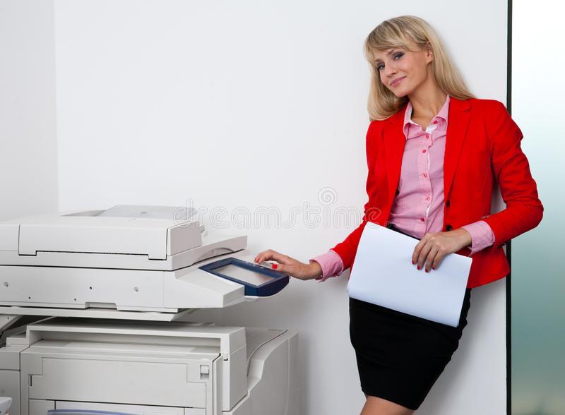 business-woman-working-office-printer-attractive-blond-machine-45367617