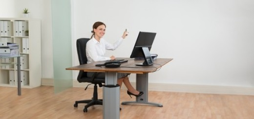 44713156 - young businesswoman sitting on chair using air conditioner in office